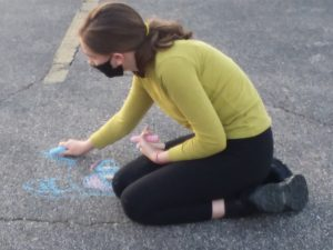 One of our youth drawing some encouraging messages in the Andover UMC parking lot.