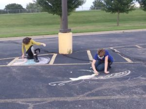 Two of our youth drawing some encouraging messages in the Andover UMC parking lot.
